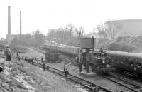 General view of the sidings at Fawley in April 1967 as USA 0-6-0T locomotives 30064+30069 pause to take on water during the LCGB <I>Hampshire Branch Lines Rail Tour</I>. The pair would take the train as far as Totton before handing over to 80151 for the next leg to Brockenhurst and Lymington Pier. <br><br>[Robin Barbour collection (Courtesy Bruce McCartney)&nbsp;09/04/1967]