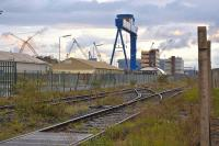 The little-used tracks leading to Rosyth Dockyard on the evening of 8 June 2011. Trains may return if Babcock Rosyth is successful with plans for an international container terminal. In the background is the Chinese-built 1000 tonne capacity 'Goliath' crane, being prepared for use in assembling aircraft carriers.<br> <br><br>[Bill Roberton&nbsp;08/06/2011]