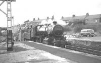 Ivatt 2-6-0 no 43121 taking water at Haltwhistle during a break in the BLS/SLS <I>'Scottish Rambler no 6'</I> railtour on 26 March 1967. The locomotive was in charge for the section which included a return trip over the Alston branch [see image 29676].<br><br>[K A Gray&nbsp;26/03/1967]