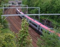 A Virgin Pendolino heads south east away from Uddingston during the evening of 9 June 2011.<br><br>[John Steven&nbsp;09/06/2011]