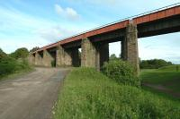 The western end of the long viaduct that spanned the Monkland Canal at Calder, between Whifflet and Airdrie, seen here in June 2011. The line, which closed in 1990, latterly served the Imperial Tube Works. <br><br>[John Steven&nbsp;10/06/2011]