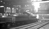 Ex-GWR 3808 takes an up goods train through Birmingham Snow Hill station in October 1964.<br><br>[K A Gray&nbsp;22/10/1964]