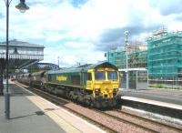 Freightliner 66604 southbound through Stirling station on 10 June 2011 with returning coal empties from Longannet power station heading for Hunterston.<br><br>[Veronica Clibbery&nbsp;10/06/2011]