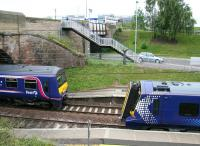 One of the class 322s long associated with the North Berwick line meets one of the new class 380 replacements at Musselburgh on 11 June 2011.<br><br>[John Furnevel&nbsp;11/06/2011]