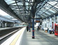 View north along platform 3 at Stirling station on 10 June as passengers await the arrival of the 14.21 service to Glasgow Queen Street.<br><br>[Veronica Clibbery&nbsp;10/06/2011]