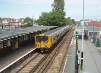 Hoylake, penultimate stop on the West Kirby branch, has notable Art Deco station buildings. The line enjoys a fifteen minute service frequency and Merseyrail EMU 508141 is seen here calling on 11 June 2011 with a Liverpool bound service.<br><br>[Mark Bartlett&nbsp;11/06/2011]