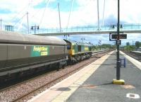 Freightliner 66604 rumbles through Stirling on 11 June with coal empties from Longannet power station heading back to Hunterston import terminal for a refill. <br><br>[Veronica Clibbery&nbsp;11/06/2011]