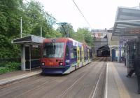 With the opening of the Midland Metro tramway in 1999 there were four tracks again on a section of the old GWR main line from Snow Hill to Wolverhampton. With Hockley tunnels just ahead, Tram No.4 calls at Jewellry Quarter on its way to Birmingham. The main line platforms lie just to the right of this picture [See image 34473].  <br><br>[Mark Bartlett&nbsp;08/06/2011]