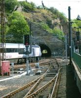 An <I>East Coast</I> London bound service leaves the east end of Waverley on 14 June and heads for the Calton Tunnel. [See image 34511]<br><br>[Veronica Clibbery&nbsp;14/06/2011]