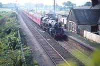 BR Standard class 4 2-6-4T no 80030 takes a Glasgow train through the closed Lochside station in August 1959. Reopened in 1966, this is the present day Lochwinnoch station (name changed in 1985).<br><br>[A Snapper (Courtesy Bruce McCartney)&nbsp;21/08/1959]