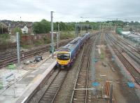 <I>Pendalongo</I> platform extensions are being constructed at various WCML stations to accommodate the planned 11 coach trains. This is the extension to Platform 4 on the Up line at Lancaster, seen here on 15th June 2011 as TPE 185109 leaves on a service for Preston. [See image 20266]<br><br>[Mark Bartlett&nbsp;15/06/2011]