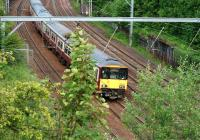 Westbound 318 251 approaching Uddingston on the evening of 9th June 2011.<br> <br><br>[John Steven&nbsp;09/06/2011]