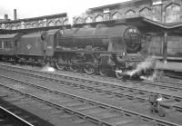Rebuilt 'Patriot' 4-6-0 no 45532 <I>Illustrious</I>, photographed at Carlisle on 4 August 1962. The train about to be taken south out of platform 4 is the 7.37am 1M31 Aberdeen - Manchester.<br><br>[K A Gray&nbsp;04/08/1962]