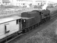 A WD 2-8-0 propelling a brake van from the Darvel direction passing under the bridge at Barleith, by Hurlford shed, in August 1962. Barleith station closed in April 1964.<br><br>[Colin Miller&nbsp;/08/1962]