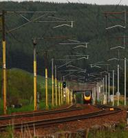 A distant Pendolino appears like a mirage in the heat. The view looks to Beattock Summit.<br><br>[Ewan Crawford&nbsp;14/06/2011]