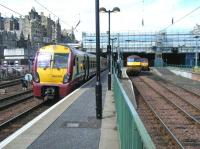 Looking back towards the east end of Waverley along platform 7 on 14 June 2011. 334002 is at the platform with 90018 and 67027 alongside in the locomotive bay.<br><br>[Veronica Clibbery&nbsp;14/06/2011]