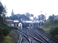 The western approach to St Andrews station seen from a DMU in the early summer of 1967, two years before the line's closure. This was the second St Andrews station with the first, a short distance north west of here, replaced in 1887 when the line from Leuchars was extended south.  Buses are visible at the top of Station Road with the spire of Hope Park Church beyond. For the same view 44 years later [see image 34391]<br> <br><br>[Frank Spaven Collection (Courtesy David Spaven)&nbsp;//1967]