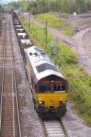DBS 66025 leaves Millerhill with the 6S58 Lackenby - Dalzell loaded slab train on 20 June.<br> <br><br>[Bill Roberton&nbsp;20/06/2011]