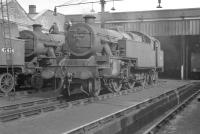 Stanier 2-6-4T no 42634 receiving attention in the shed yard at Lostock Hall on 25 September 1960. Classmate 42434 stands on the left with Fairburn 42286 at the rear of the group.<br><br>[K A Gray&nbsp;25/09/1960]