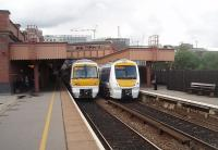 GWR details are everywhere at Birmingham Moor Street. Two Chiltern trains occupy the through lines under restored canopies and footbridge. 168002 on the left is heading for Snow Hill while 168108 is on a Marylebone service.<br><br>[Mark Bartlett&nbsp;08/06/2011]