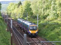 First TransPennine Express 1706 hrs service from Glasgow Central to <br> Manchester Airport descending Beattock near to Auchen Castle on 30 May 2011. The M74 is nicely screened from view by the trees on right!<br> <br><br>[John McIntyre&nbsp;30/05/2011]