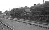 Sunday 27 August 1967 on Kingmoor shed. Face to face in the the north yard are Black 5s 45038 and 44674. The Britannia in the background is 70038 <i>Robin Hood</i> which had been officially withdrawn by BR a couple of weeks earlier. <br><br>[Bill Jamieson&nbsp;27/08/1967]