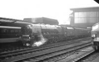 Stanier Pacific no 46250 <I>City of Lichfield</I> awaits 'the off' on a damp February morning at Carlisle in 1964. The locomotive is about to take out the 9am Perth - Euston.<br><br>[K A Gray&nbsp;29/02/1964]