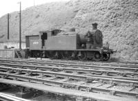 Reid C16 4-4-2T no 67489 dumped at the north end of Hawick shed in the summer of 1958.<br><br>[Robin Barbour Collection (Courtesy Bruce McCartney)&nbsp;08/06/1958]