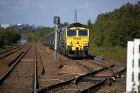 Freightliner Heavy Haul have a short term contract to move imported coal from Leith Docks to Longannet Power Station thrice-daily, via Dunfermline and Culross.<br/><br> 66548 and empties from Longannet in the down loop at Townhill.<br><br>[Bill Roberton&nbsp;28/06/2011]