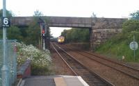 A Freightliner class 66 with a coal train emerging from<br> Townhill sidings and approaching Dunfermline Queen Margaret station on 23 June 2011.<br><br>[Grant Robertson&nbsp;23/06/2011]