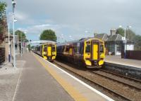 Services crossing at Nairn on the afternoon of 300611. 158702 on the left is heading for Inverness while 158719 is bound for Aberdeen. View east towards Forres.<br><br>[Mark Bartlett&nbsp;30/06/2011]