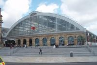 One of the two Lime Street trainsheds fronts directly on to the road outside, while the second is hidden behind a building. Refurbishment has given the station a light and airy feel as seen in this picture. Note the prominent double arrow symbol on the glass screen. <br><br>[Mark Bartlett&nbsp;24/06/2011]
