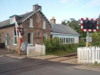 The former Dalcross station, between Inverness and Nairn, viewed from the north side of the level crossing in July 2011. The station closed in 1965 and like a number of others on this line is now a private residence. If a new station opens for Inverness Airport as proposed it will be sited to the east of here.<br><br>[Mark Bartlett&nbsp;01/07/2011]