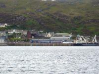 158706 unloads passengers at Kyle of Lochalsh on 22 June, following arrival at 11.28 with the service from Inverness. Photographed from the former Kyleakin ferry slipway. <br><br>[David Pesterfield&nbsp;22/06/2011]