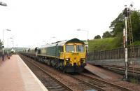 Southbound coal through New Cumnock on 27th June 2011 behind Freightliner 66606.<br><br>[Colin Miller&nbsp;27/06/2011]