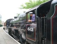 <I>'Wonder what The Bishop would have thought?'</I> The driver of ex-LMS 45428 <I>Eric Treacy</I> seems to be quite taken with the partial LNER green colour scheme created by the reflection of the summer foliage at Pickering on 28 June 2011. The locomotive is about to take out a morning NYMR service to Grosmont.<br><br>[John Furnevel&nbsp;28/06/2011]