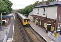 A Southport - Liverpool Central EMU arrives at Hightown station on the Merseyrail Northern line on Sunday afternoon 26 June 2011. Like many stations on Merseyrail, the booking office here is open on a Sunday.<br><br>[John McIntyre&nbsp;26/06/2011]