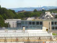View over the ongoing re-glazing works at Waverley Station and along the Firth of Forth to the twin chimneys of rail served Cockenzie Power Station. The Edinburgh Council offices stand beyond the station.<br><br>[David Pesterfield&nbsp;24/06/2011]