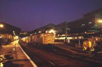 The 20.10 stopping train to Basingstoke about to leave Exeter St Davids on a November evening in 1983.<br><br>[Ian Dinmore&nbsp;13/11/1983]