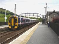 158736 trailing Turbostar 170409 pulls away from the northbound platform at Blair Atholl on 22 June 2011 with the 17.59 departure to Inverness. <br><br>[David Pesterfield&nbsp;22/06/2011]