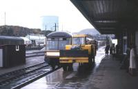 The <I>'Devon Belle'</I> observation car can be glimpsed behind a strange piece of BR platform equipment at Kyle of Lochalsh on a dreich October day in 1966. The tractor was used to shunt fish vans on the quayside and the planking was to cushion the buffers. [With thanks to Adrian Morgan]<br><br>[Frank Spaven Collection (Courtesy David Spaven)&nbsp;/10/1966]