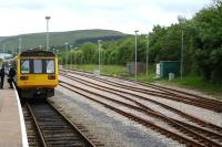 142073 and a sister unit wait at the platform at Rhymney prior to returning south with the 17.29 service to Penarth on the afternoon of 8 June 2011. The refurbished stabling sidings and run round loop stand on the right. <br><br>[David Pesterfield&nbsp;08/06/2011]