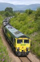 Freightliner 66510 passing through Clackmannan on 13 July with the 6G05 Ravenstruther - Longannet FHH coal train.<br> <br><br>[Bill Roberton&nbsp;13/07/2011]