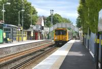 A Southport bound ecs movement enters Freshfields station on 26 June <br> 2011. <br><br>[John McIntyre&nbsp;26/06/2011]
