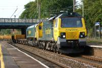 A Freightliner hauled Network Rail engineers train passes south <br> through Leyland on 11 July 2011 with 70005 leading and dead 66511 tucked inside. <br> <br><br>[John McIntyre&nbsp;11/07/2011]