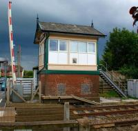 <I>'Looks like more rain on the way.'</I> Under a heavy sky on 6 July, Carleton Crossing signalbox stands alongside the line to Blackpool North. [Shortly after taking the photograph the heavens opened!]<br> <br><br>[John McIntyre 06/07/2011]