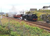 The much reduced station at Mallaig on 13 July 2011. 156485 has just arrived from Fort William and Black 5 45231 wreathes the station (and observers) in smoke as it departs with the return working of 'The Jacobite'.<br> <br><br>[John Gray&nbsp;13/07/2011]
