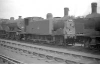 McIntosh 0-6-0T no 56332 stands out of use in the shed yard at Kingmoor in the summer of 1959, some 3 months prior to official withdrawal by BR.<br><br>[Robin Barbour Collection (Courtesy Bruce McCartney)&nbsp;04/07/1959]