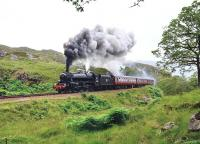 On Wednesdays, Thursdays and Fridays until the end of August there are two steam hauled excursions on the Mallaig extension. Here we see 44871 hammering up the 1 in 48 Beasdale Bank with the second train of the day. The headboard reads <I>'The Cambrian'</I> for reasons unknown.<br><br>[John Gray 14/07/2011]