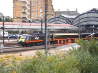 At first glance it could be mistaken for a guard of honour in corporate colours waving a Grand Central service away from York station. It is in fact a Network Rail PW team standing clear as the 11.23 Kings Cross - Sunderland service restarts from York on 29 June 2011.<br><br>[John Furnevel&nbsp;29/06/2011]